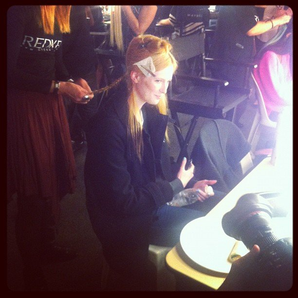 We spy with our little eyes... Aussie model Alice Burdeu getting primped backstage at MBFF.