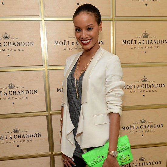 Selita Ebanks Carrying Neon Green Clutch