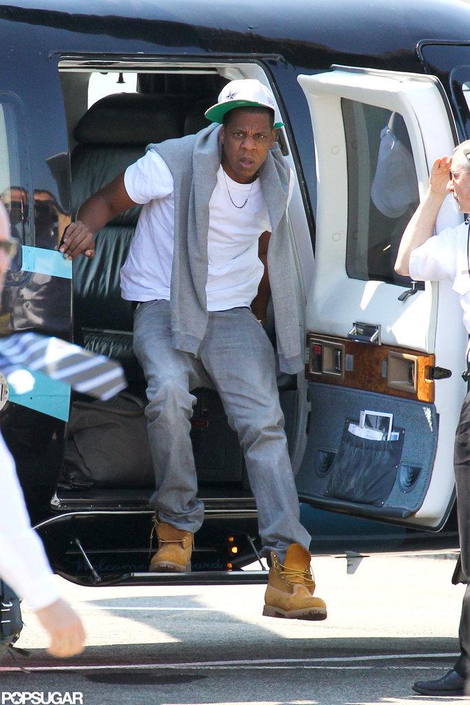 Jay-Z got out of a chopper.