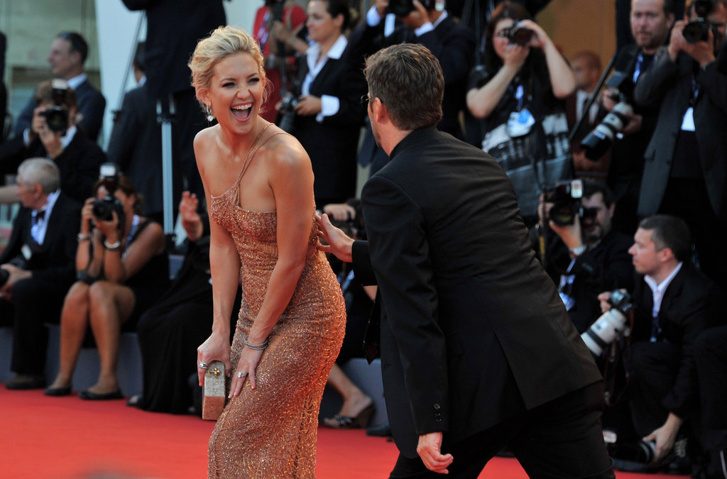 Kate Hudson had a laugh on the red carpet at The Reluctant Fundamentalist premiere and opening ceremony of the Venice Film Festival on August 29.