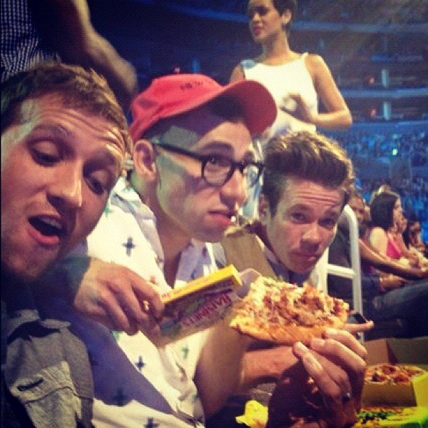 Fun. snacked on pizza during the show. Source: Instagram user mtv