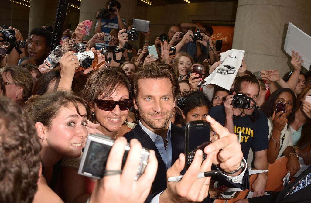 Ryan Gosling and Eva Mendes Pose at TIFF With Bradley Cooper