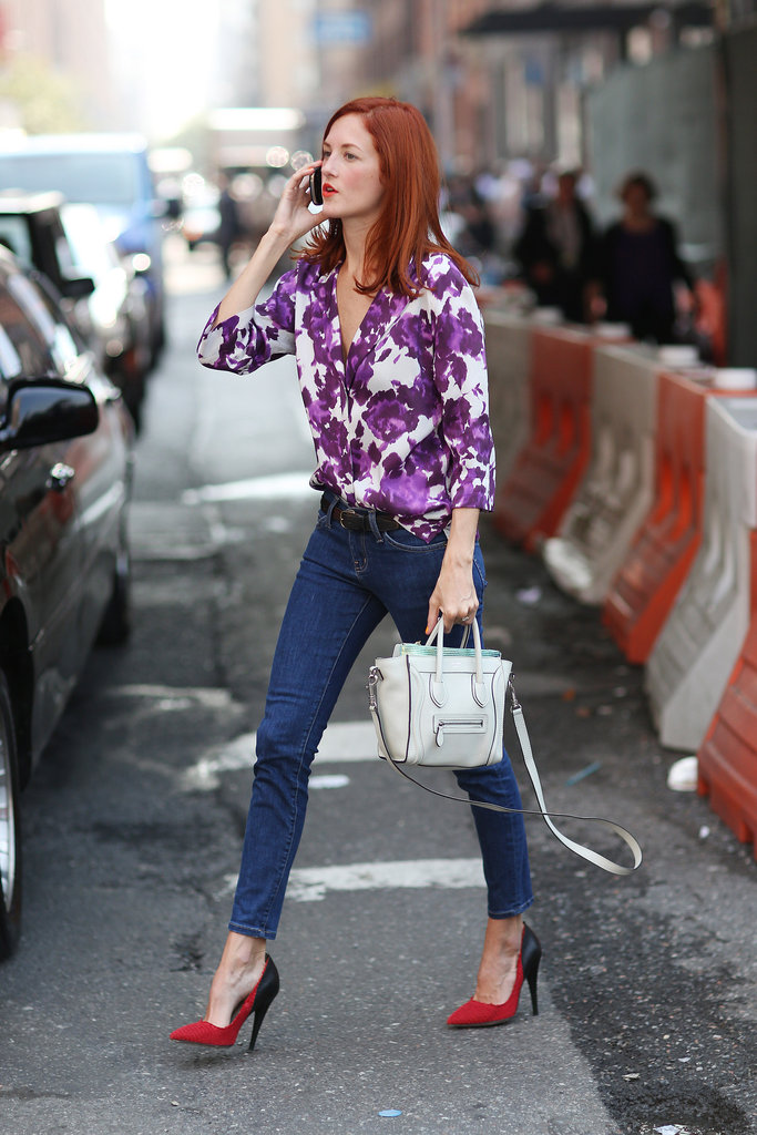 Taylor Tomasi Hill kept it easy and chic in a floral blouse, skinny denim, and pointed-toe heels. Source: Greg Kessler