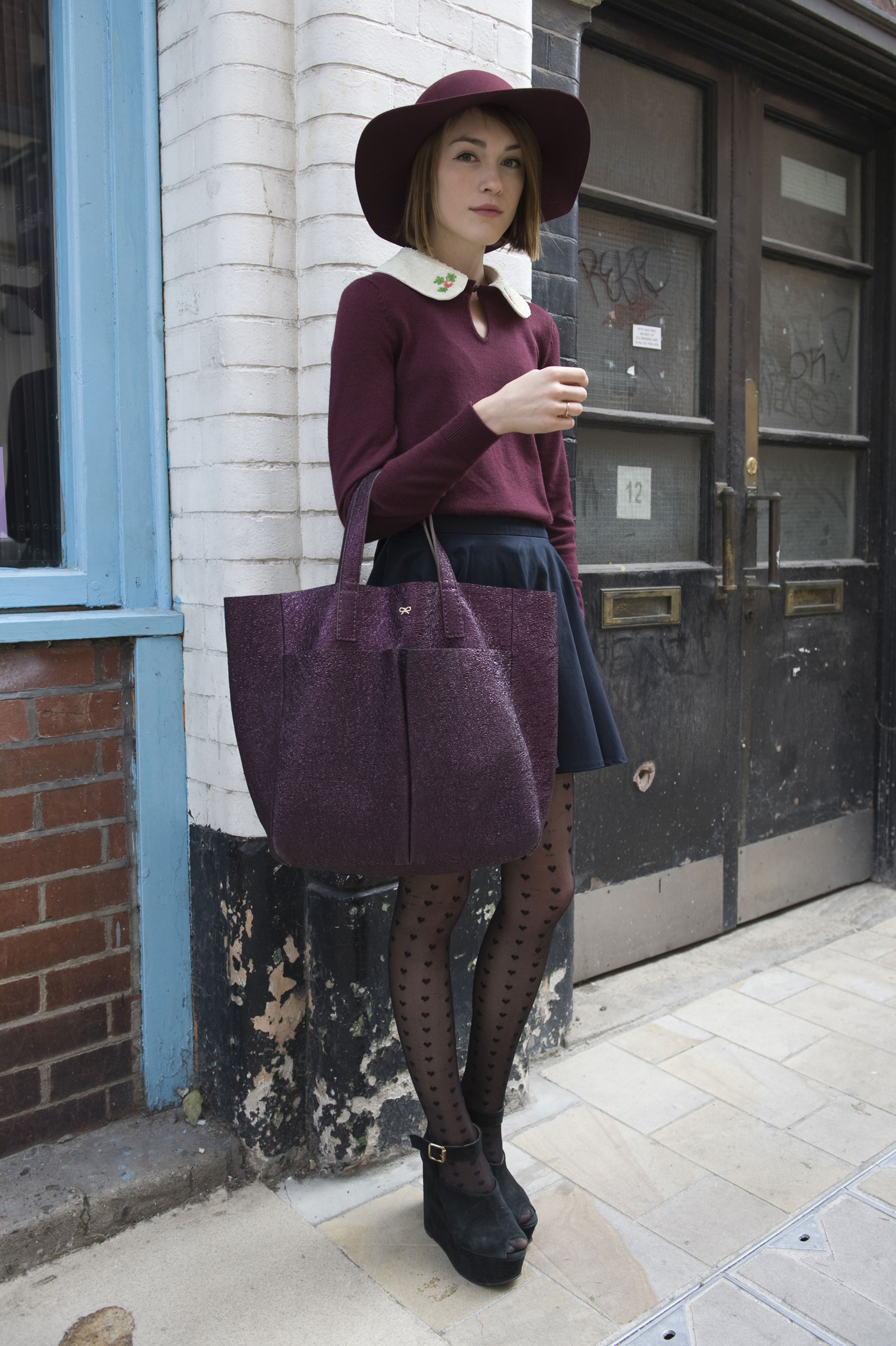 A boho hat and burgundy hues took the limelight in this ladylike look.