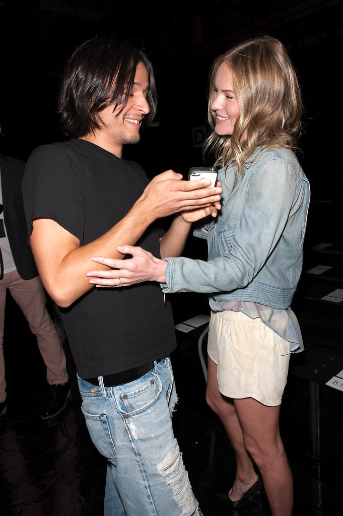 Kate Bosworth and Olivier Theyskens joked around backstage.