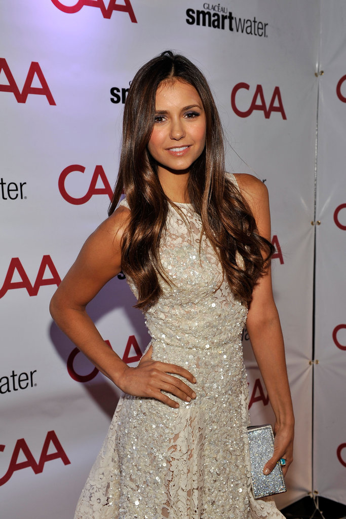 Nina Dobrev was spotted at a TIFF party in a sparkly white cocktail dress and pretty loose waves.