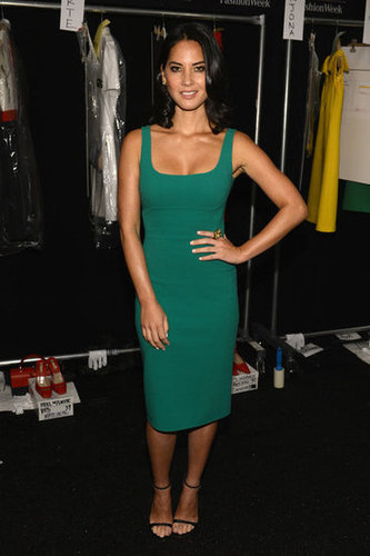 Olivia Munn showed off her curves in an emerald-green Michael Kors shift backstage at the show.