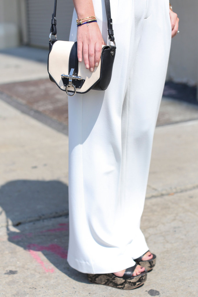 A structured black and white crossbody played opposites to easy, breezy white pants.