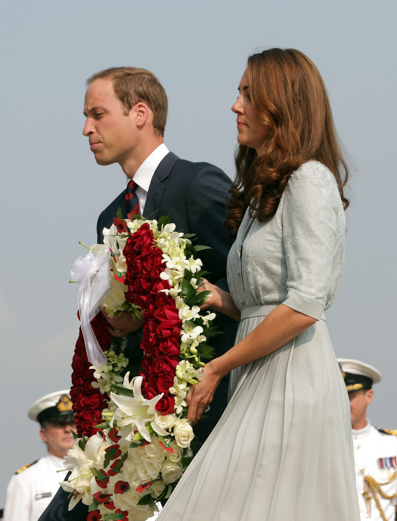 Prince William and Kate Middleton present a wreath of flowers at the Kranji War Memorial in Singapore.