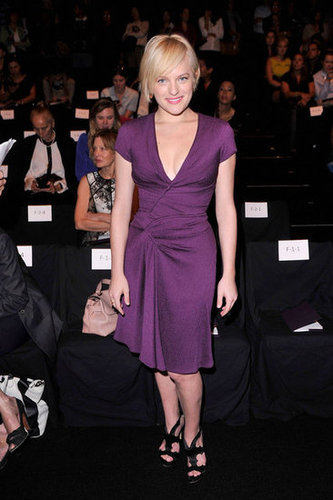 Mad Men's Elisabeth Moss took front row in a violet-hued wrap-style dress (and blond locks!) at J. Mendel.