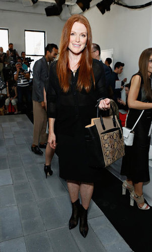 Julianne Moore toted a Reed Krakoff bag alongside an understated ensemble at the designer's Spring show.