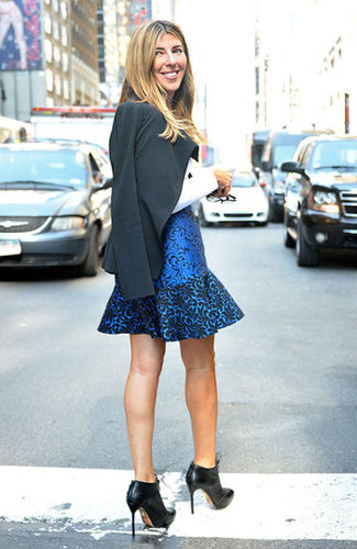 Nina Garcia worked a gorgeous fit-and-flare mini with a pair of lace-up ankle boots.