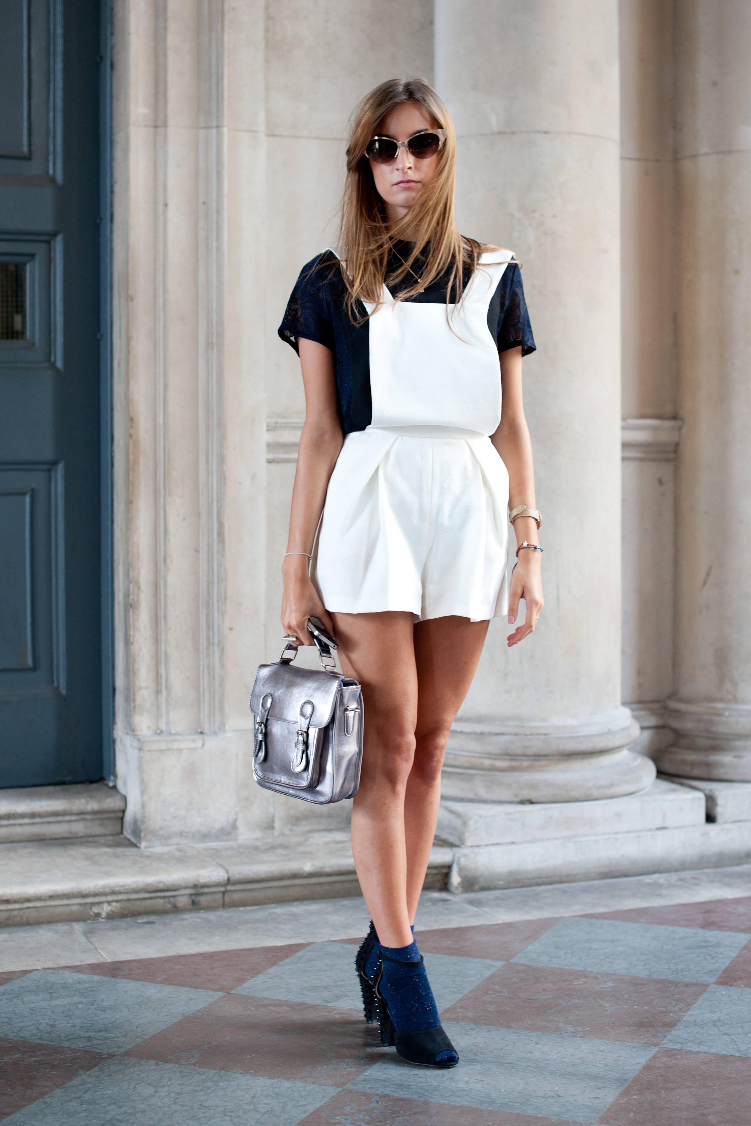 We're digging the funky throwback mashup of white Topshop overalls and a metallic silver Urban Outfitters bag here — it's '90s retro but totally accessible.