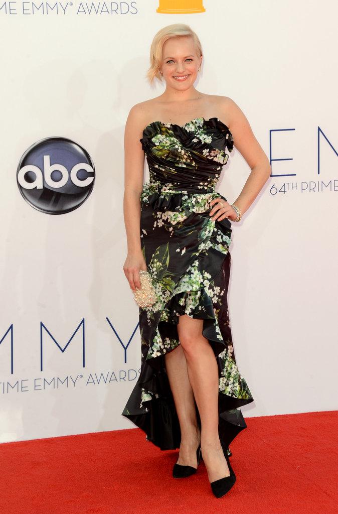 Elizabeth Moss showed off her legs in her dress.
