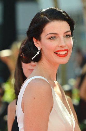 Jessica Pare wore bright red lips on the red carpet at the Emmy Awards.