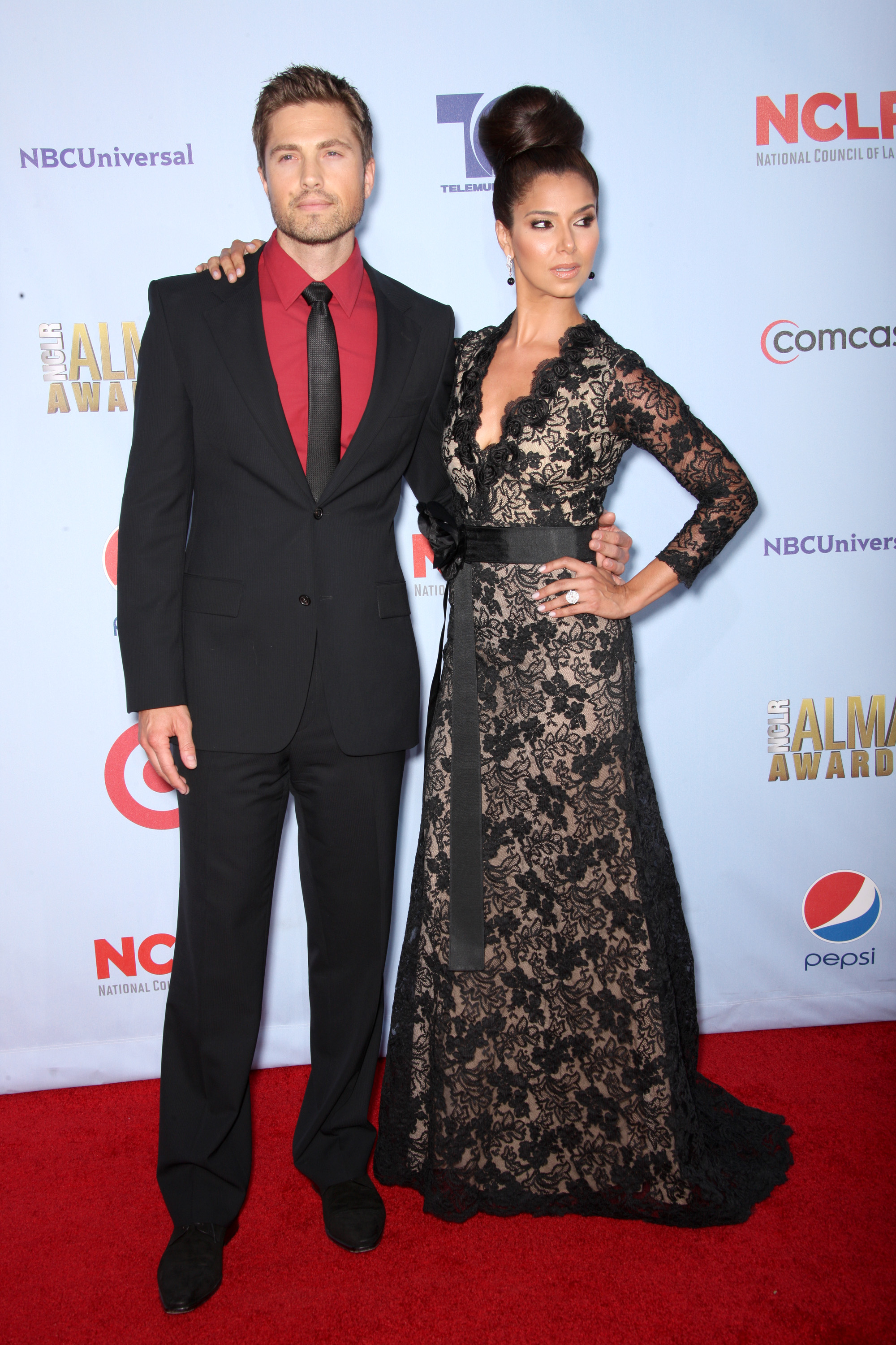 Roselyn Sanchez and Eric Winter posed.