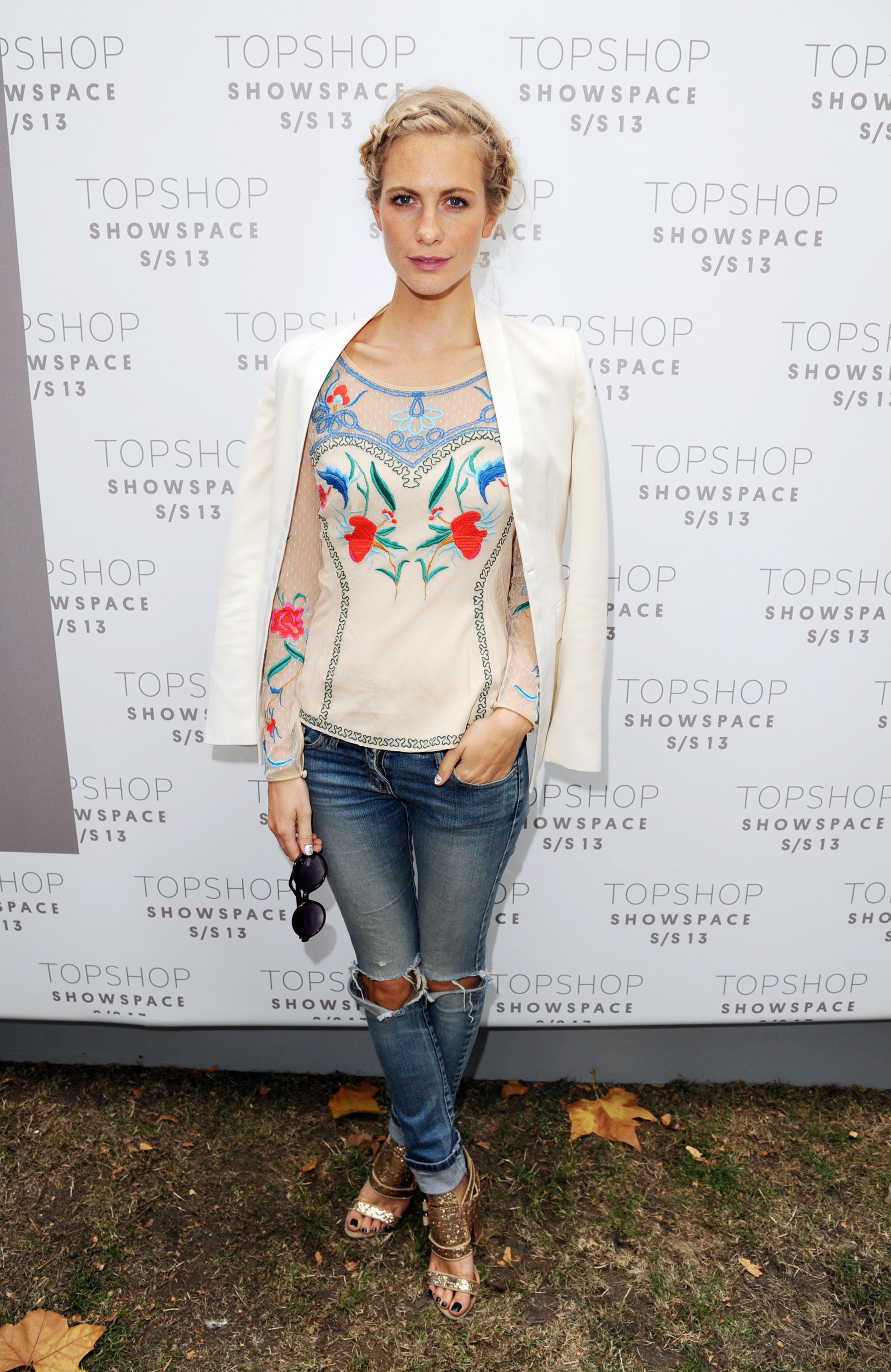 Poppy Delevingne paired an embroidered top with a sleek white blazer at U