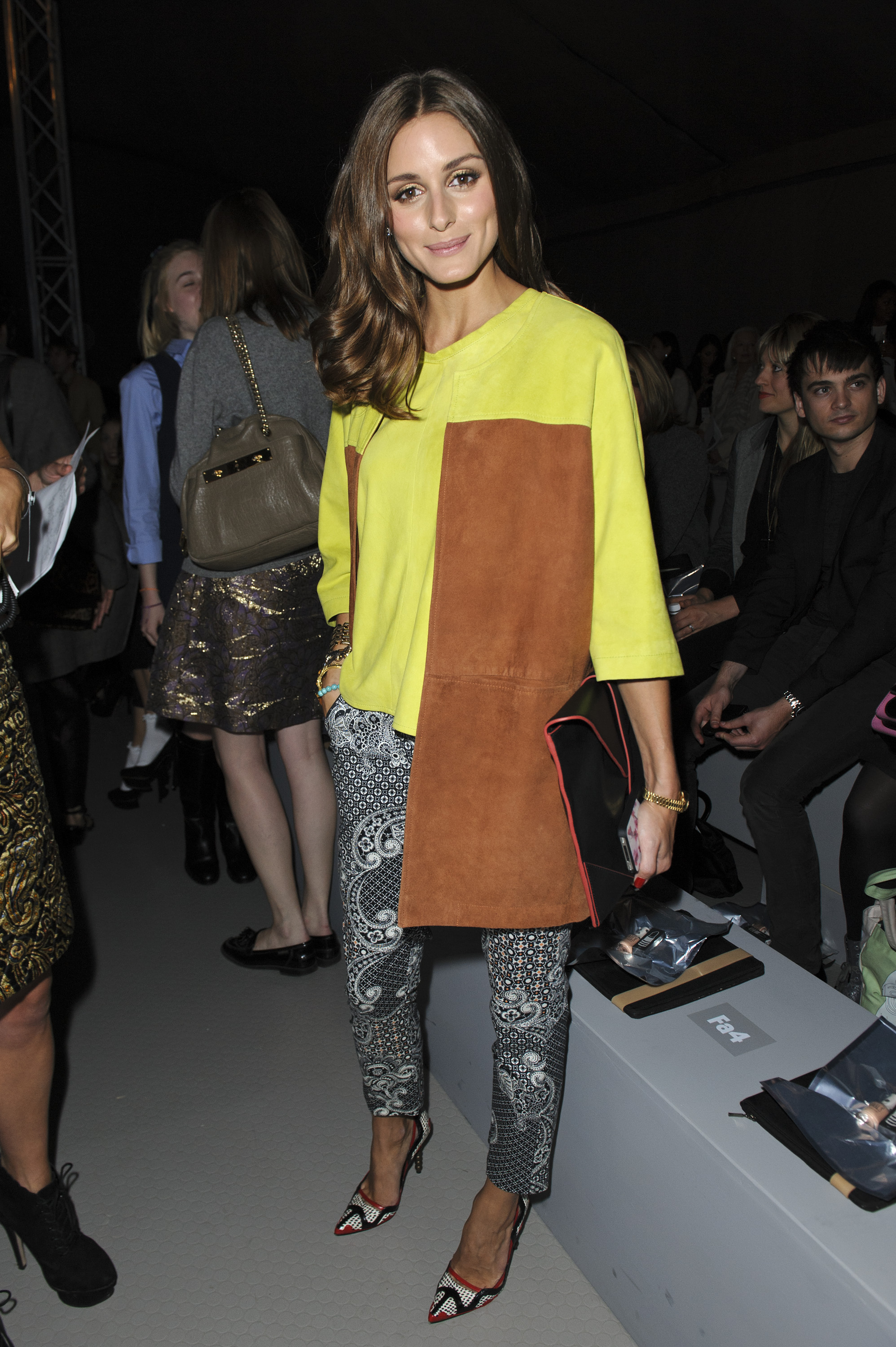 Olivia Palermo turned up in the front row of Unique at London Fashion Week in a unique take on neon, print, and suede.
