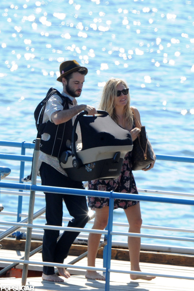 Tom Sturridge and Sienna Miller carried baby Marlowe off of a boat in her carrier.