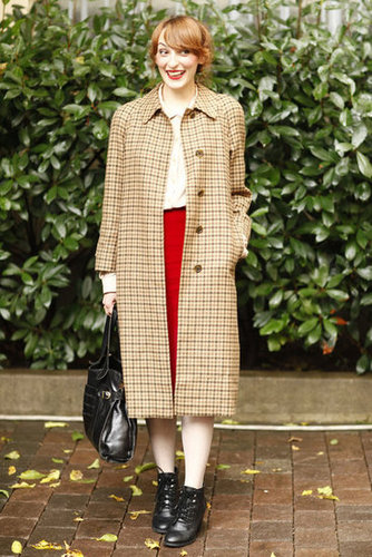 This plaid coat furthered the classic appeal of a red pencil skirt and button-down blouse. Source: Greg Kessler