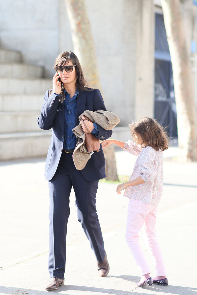 This mom kept stylish in navy suiting, with her daughter in tow.