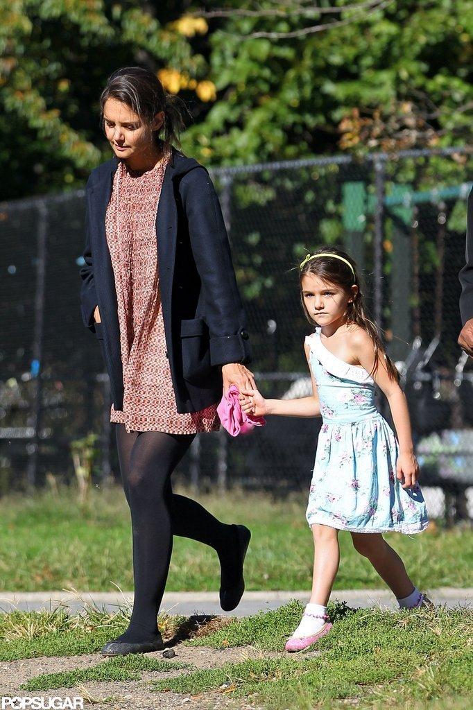 Suri Cruise held Katie Holmes's hand leaving the playground.