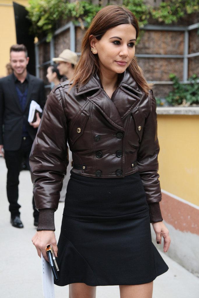 A voluminous aviator-style jacket provides a slick contrast to a trumpet hem skirt. Source: Greg Kessler