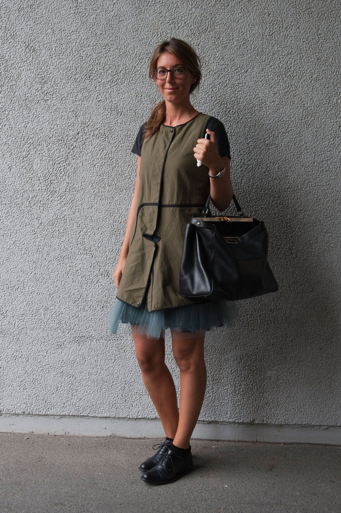 The hint of girlie tulle beneath this laid-back khaki green bib-sheath is the perfect example of stylish juxtaposition. Source: IMAXtree