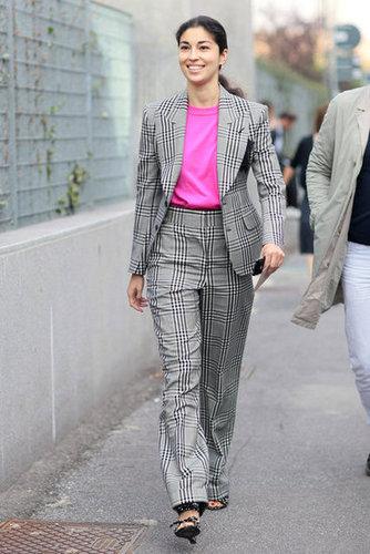 Assert your girlier side á la Caroline Issa with a pink pop against a plaid-print pantsuit. Source: Greg Kessler