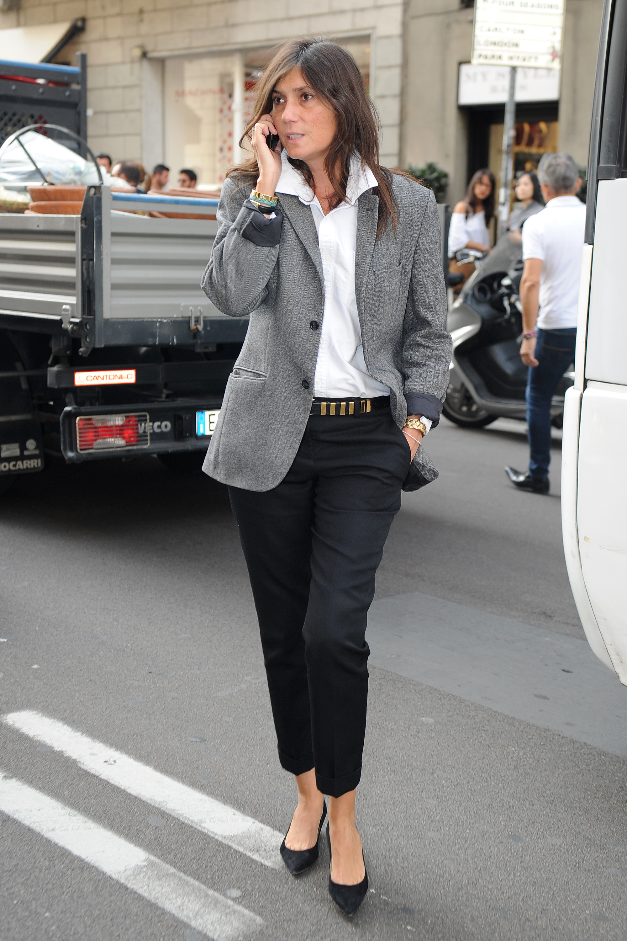 Emmanuelle Alt strikes the perfect monochromatic balance in chic tailored separates en route to Blumarine in Milan.