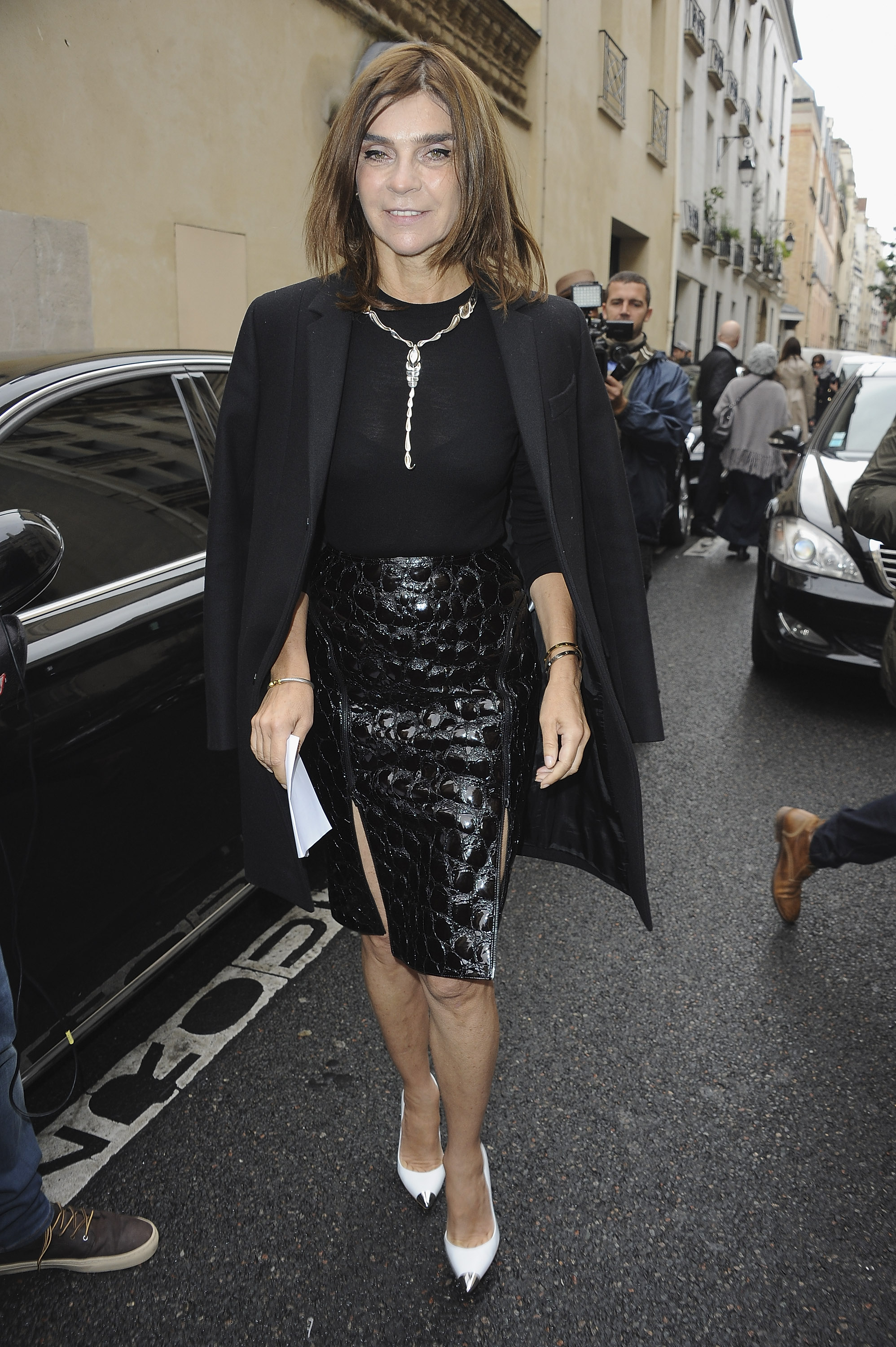 At Balmain, Carine Roitfeld did the jacket-on-the-shoulders thing so well, but this time around, we only had eyes for that ultrasexy croc-print skirt.