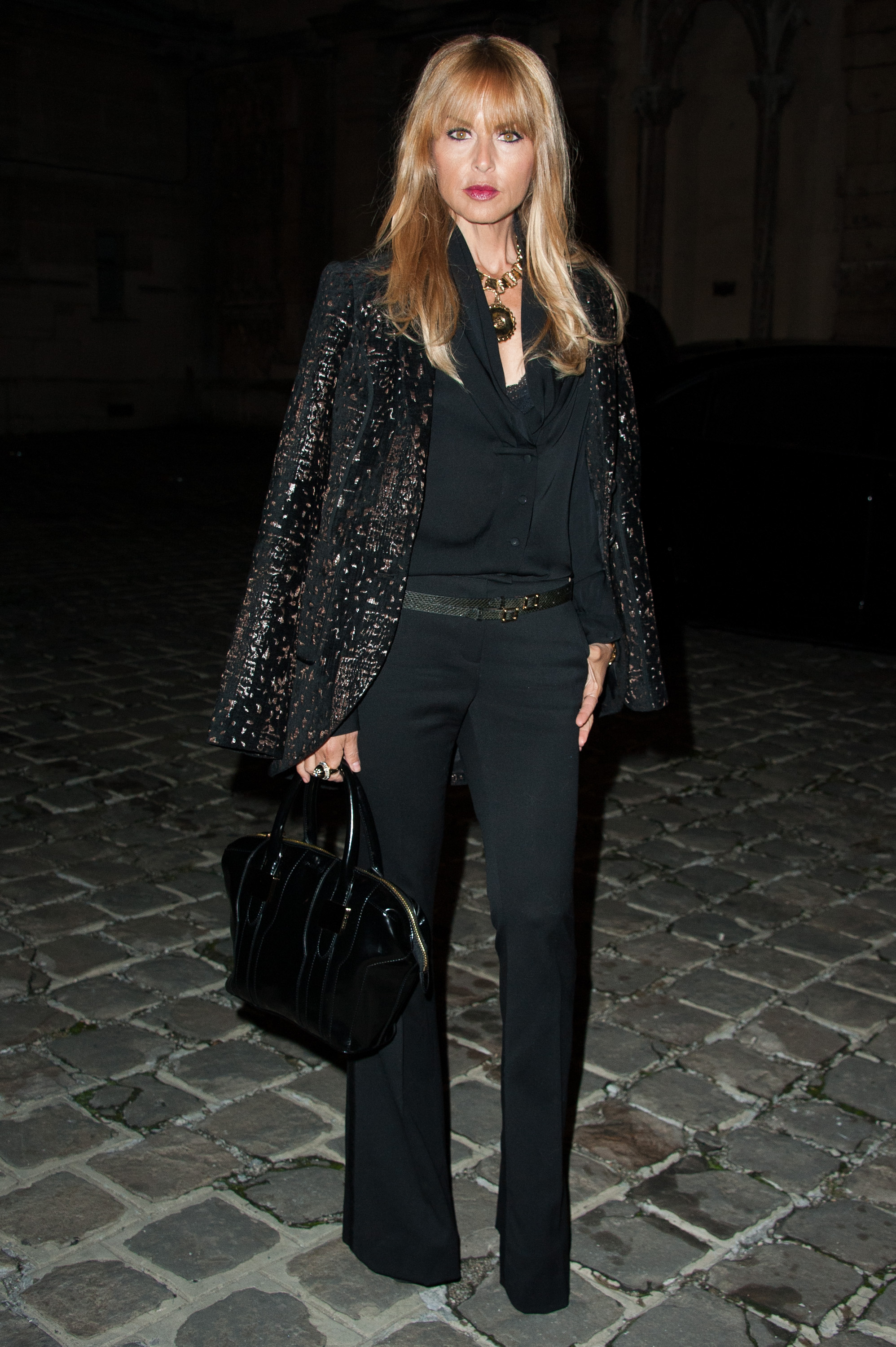 Rachel Zoe, with bangs, donned her signature wide-leg silhouette and a jacket-slung-on-the-shoulders look at the Lanvin show.