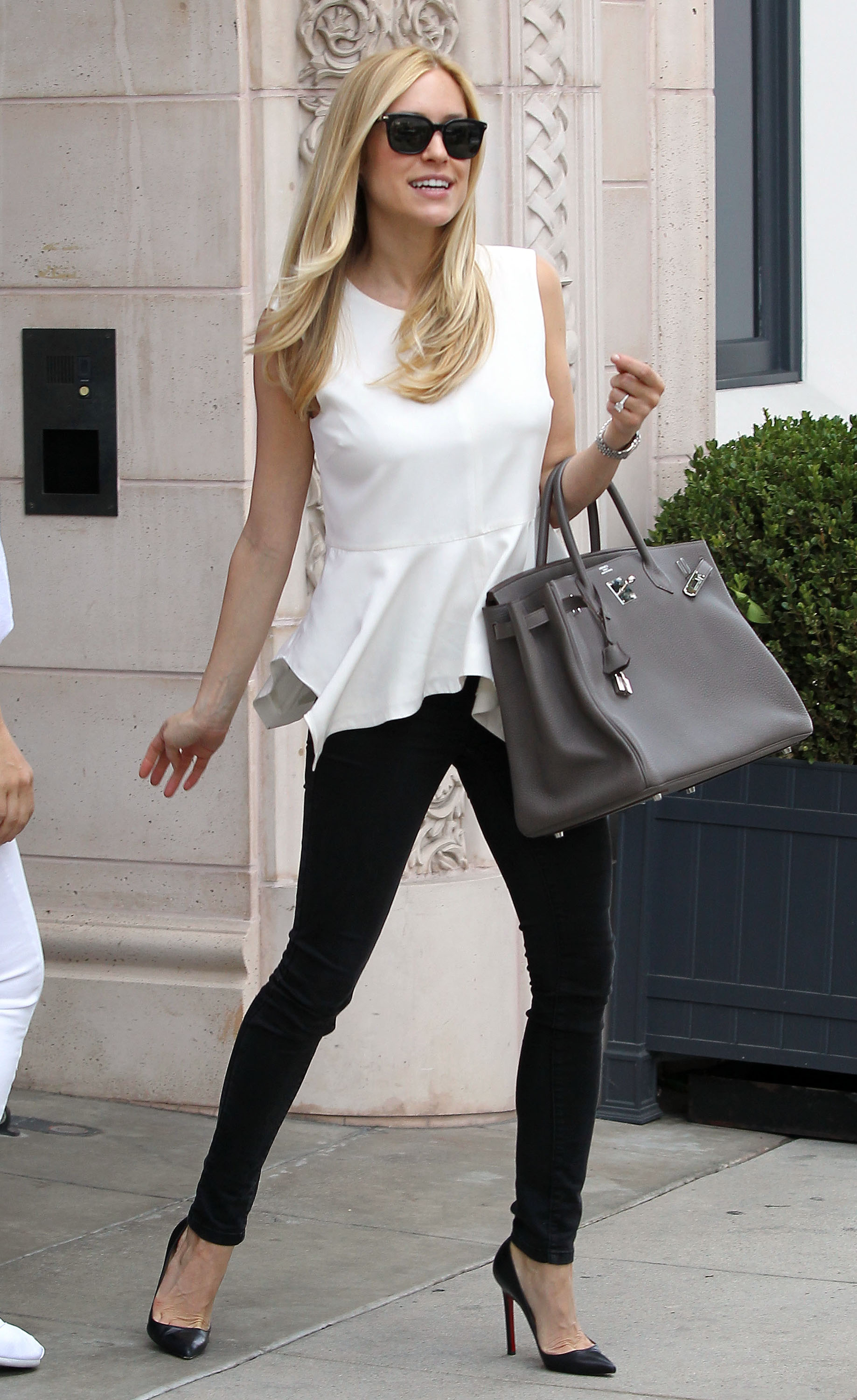 Kristin Cavallari showed off her did-she-really-just-have-a-baby?! body in a breezy peplum top and skinny black jeans out in LA.
