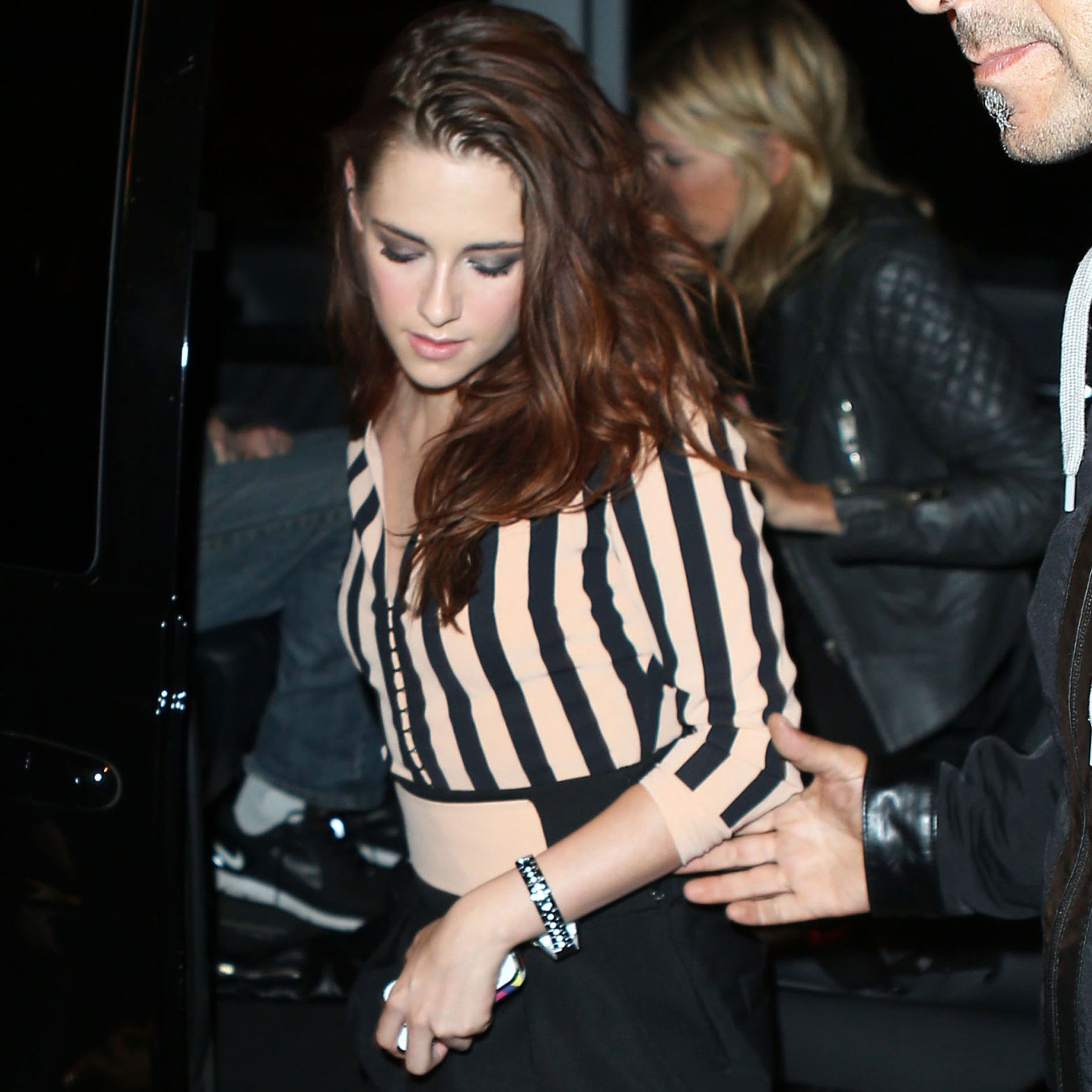 Kristen Stewart hit the town in Paris in a cream and black striped number, the second outfit to showcase her penchant for a monochromatic palette.