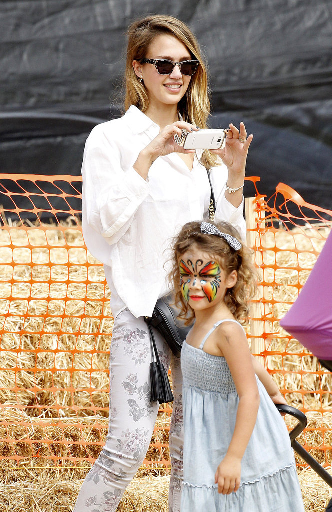 Jessica Alba snapped photos of daughter Honor Warren at the pumpkin patch in LA.