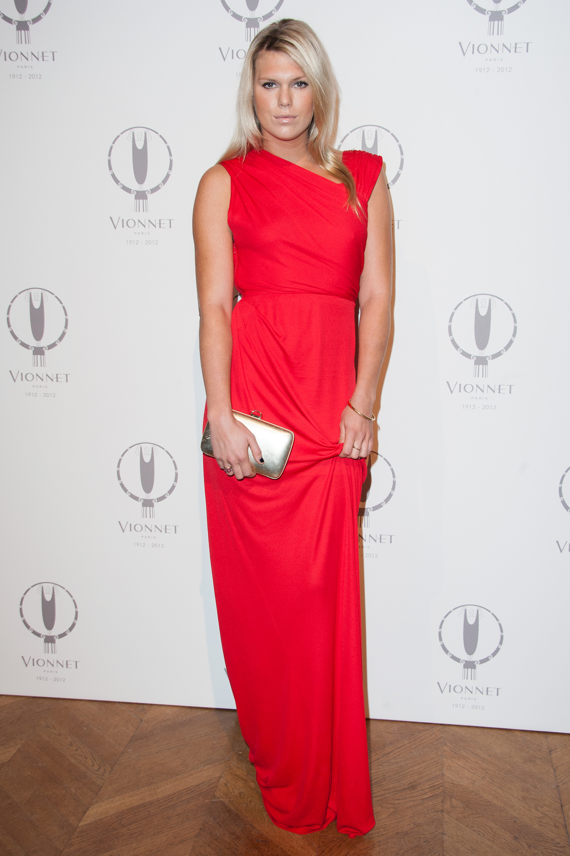 Alexandra Richards opted for statement red, in this simple, but totally chic, gown at the 100th anniversary party for Vionnet.