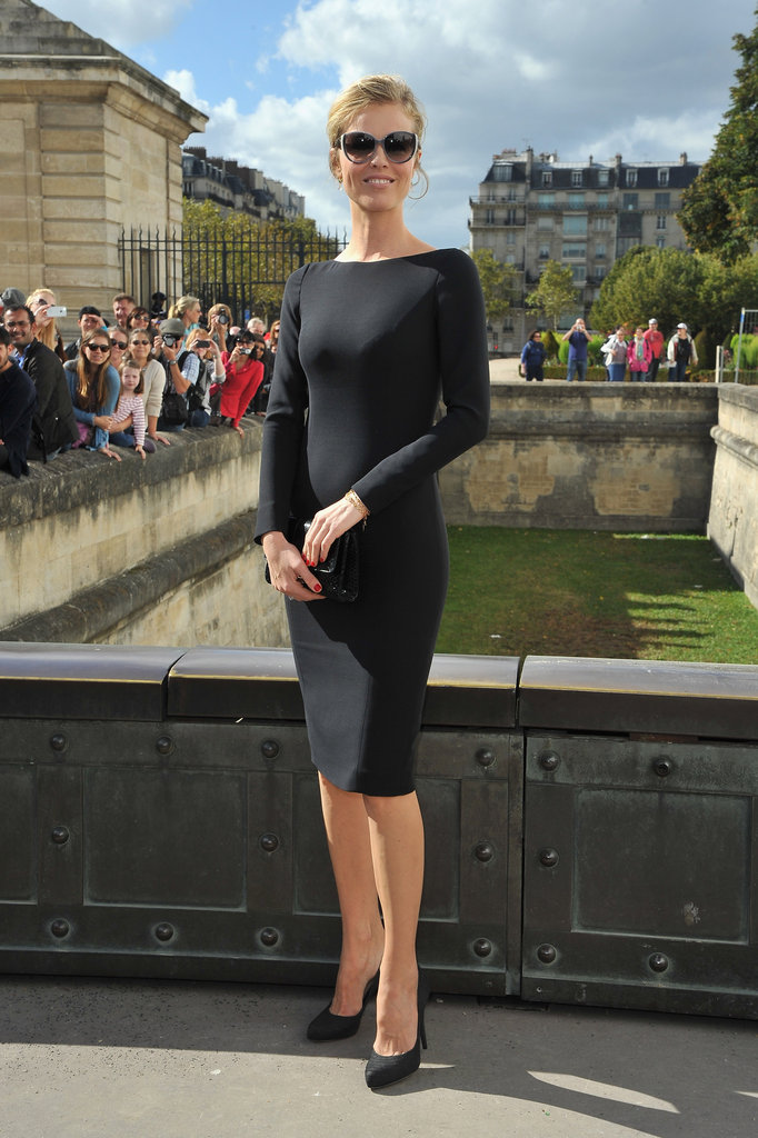 Eva Herzigova kept it chic in a long-sleeved LBD and matching black pumps for the Christian Dior show.