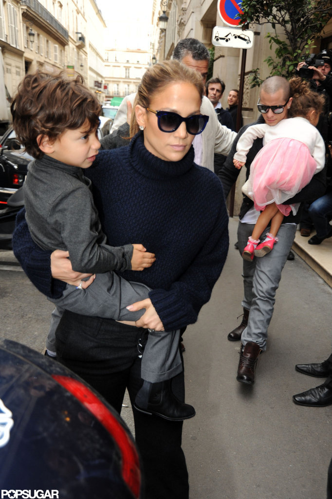 Jennifer Lopez held onto Max Anthony while Casper Smart followed closely behind with Emme Anthony in his arms.