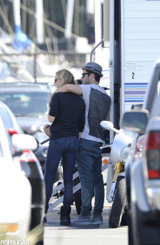 Joshua Bowman had his arm around Emily VanCamp on the set of Revenge together in LA.