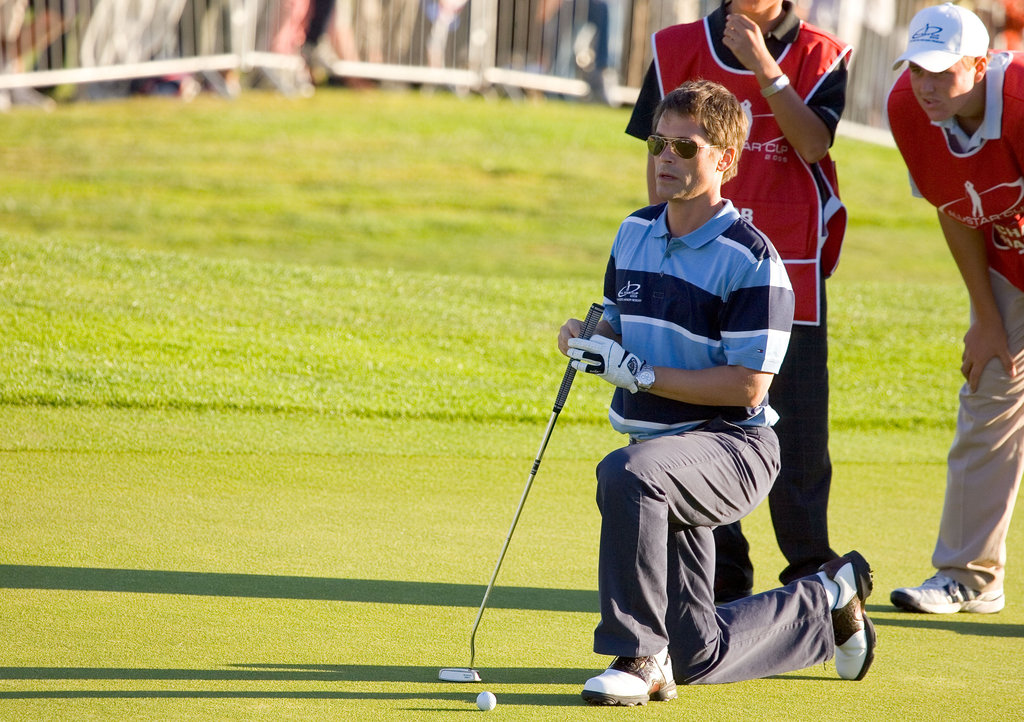 Rob Lowe had help with his shot at the August 2005 All Star Golf Cup in Newport, United Kingdom.
