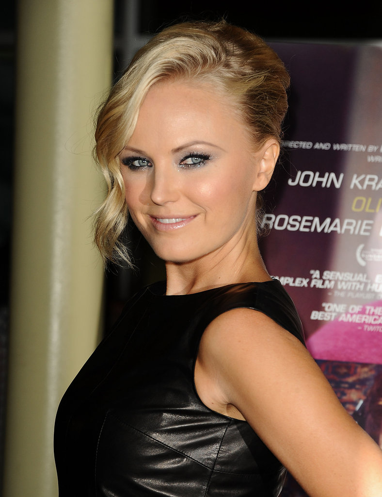 Malin Akerman hit the red carpet solo.