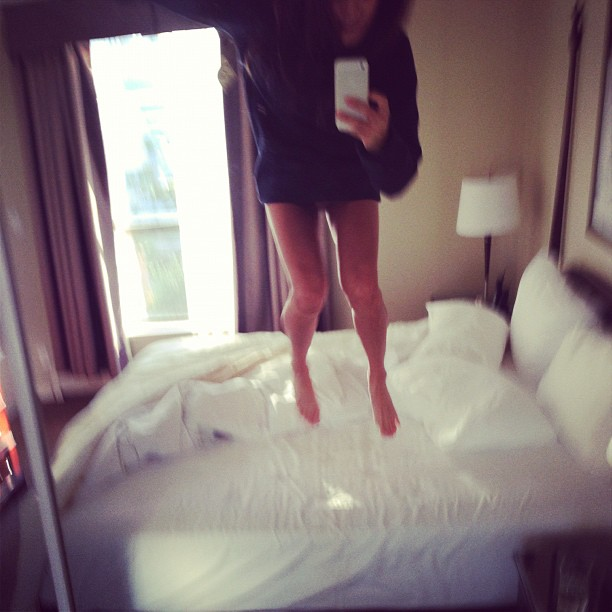 Jamie Chung jumped on her hotel room bed. Source: Instagram user jjchung415