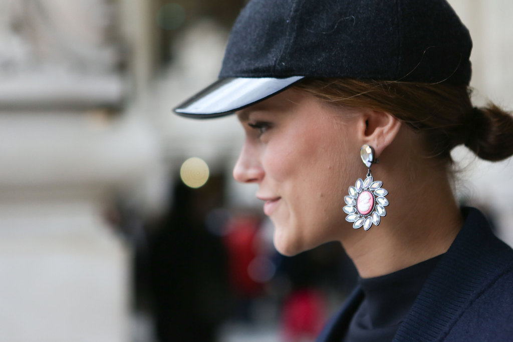 Rhinestone earrings and a tomboy-inspired cap played opposites in this ensemble.