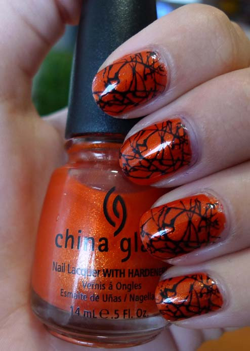 Looking for a little glitz and glam this Halloween? This webbed design was achieved using China Glaze's shimmery Orange Marmalade as a base. Then Konad's image plate M70 was used on top for a paint-splattered effect. Source: Flickr user tina.velechovsky
