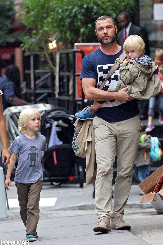 Liev Schreiber carried Kai Schreiber while Sasha Schreiber walked next to them in NYC.