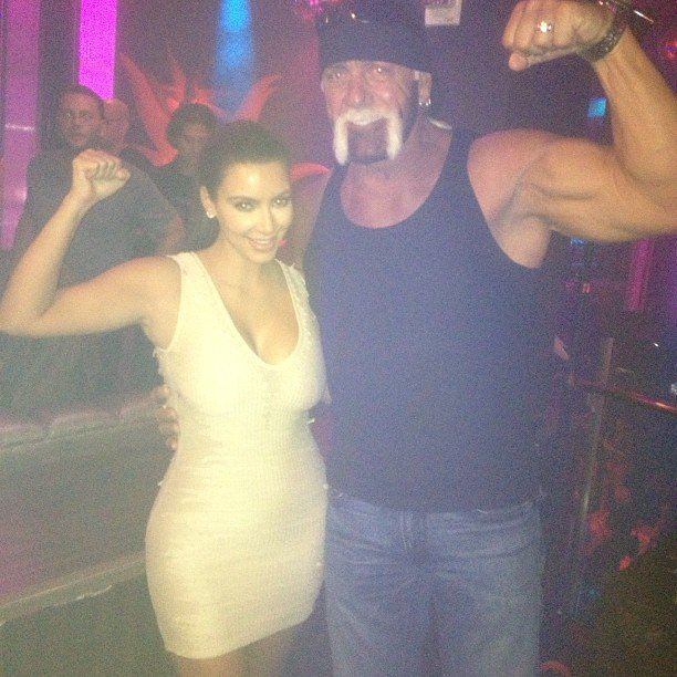 Kim Kardashian flexed her muscles for a photo with Hulk Hogan. Source: Instagram user kimkardashian