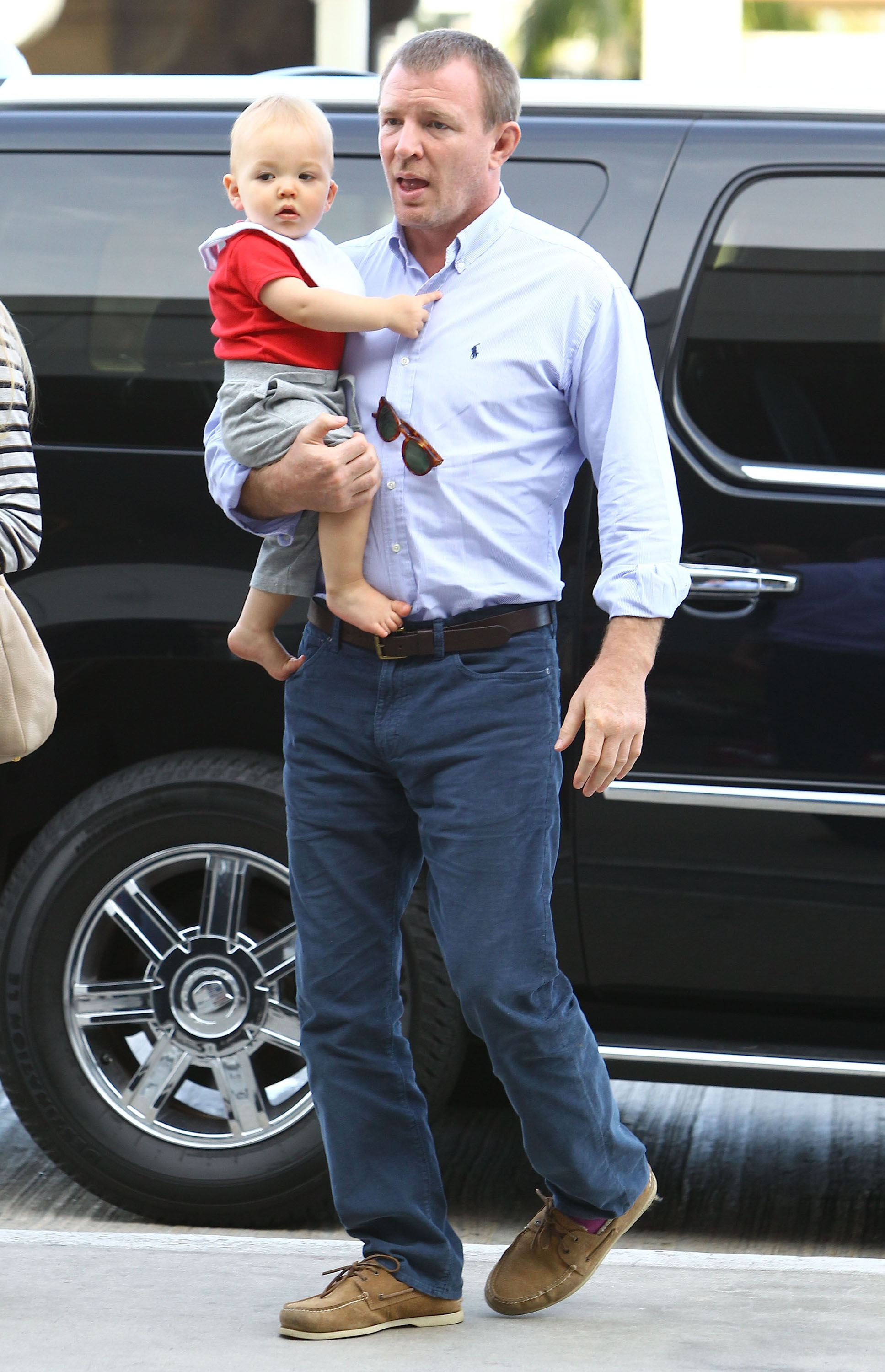 Guy Ritchie carried his son Rafael.