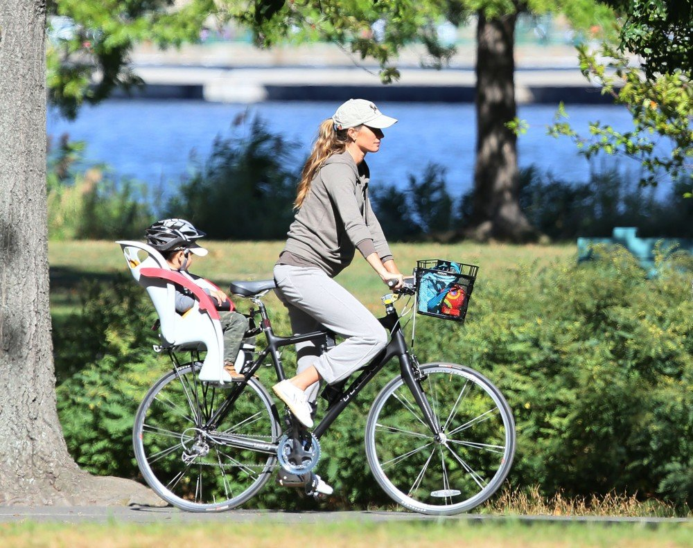 """Known for maintaining a strict exercise regime, Gisele Bundchen eagerly shared her prenatal exercise routine while pregnant with Ben, """"I did kung fu up until two weeks before Benjamin was born, and yoga three days a week.""""  Now expecting her second child, she's been spotted riding a bike and leaving gym classes recently."""