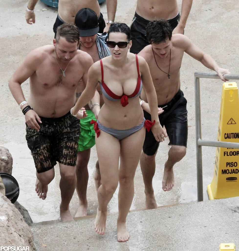 Katy hit the beach in the Bahamas in July 2010 wearing a bikini with red ties.