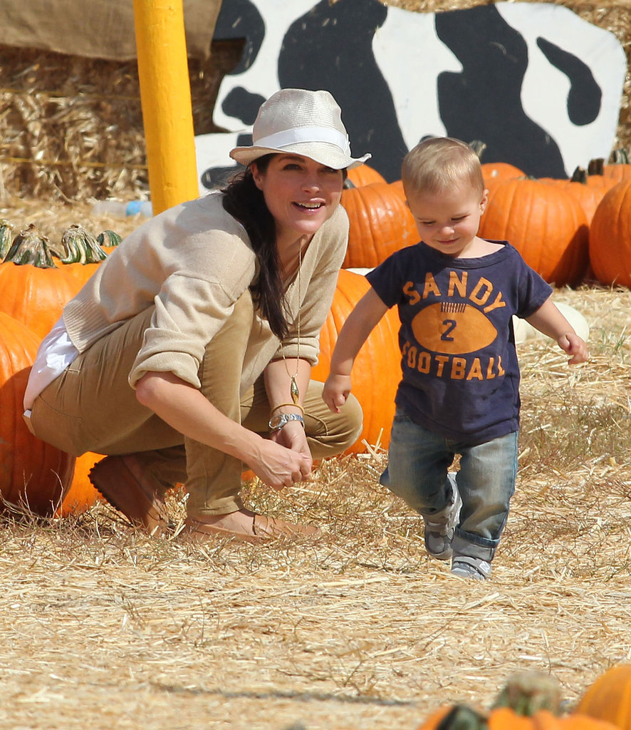 Selma Blair watched over son Arthur as he ran around in the hay at an LA pumpkin patch this October.